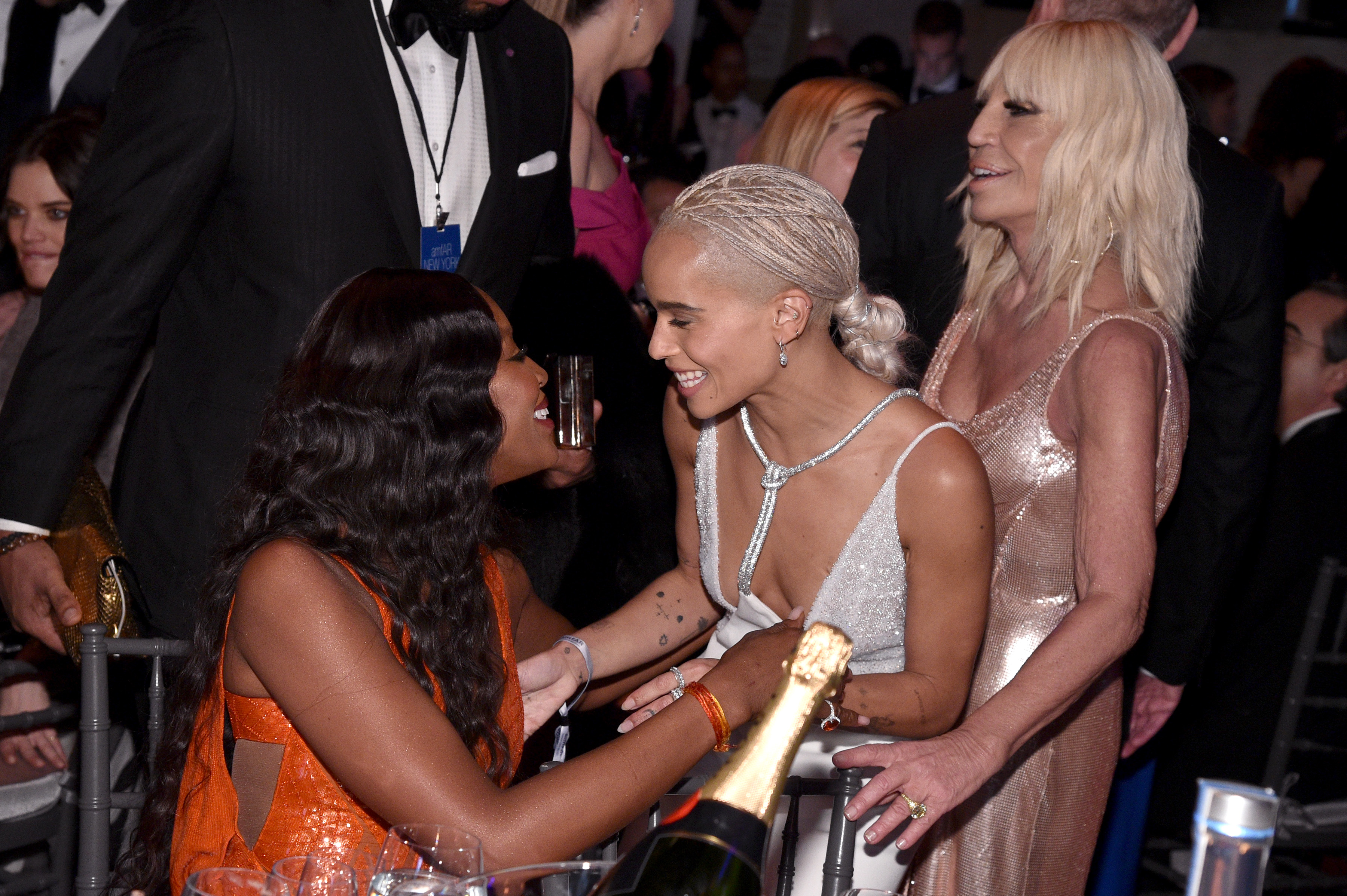 NEW YORK, NY - FEBRUARY 08:  Naomi Campbell Zoe Kravitz and Donatella Versace attend as Moet & Chandon Toasts to the amfAR New York Gala At Cipriani Wall Street at Cipriani Wall Street on February 8, 2017 in New York City.  (Photo by Bryan Bedder/Getty Images for Moet & Chandon)